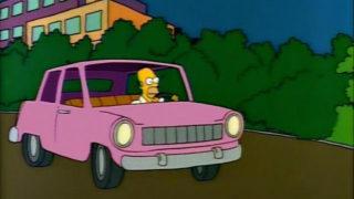 Homer Simpson in automobile.